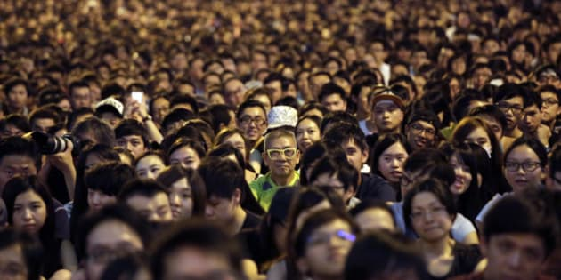 Thousands of pro-democracy activists attend a rally on the streets near the government headquarters, Saturday, Oct. 4, 2014 in Hong Kong. Hong Kong arrested 19 people, some believed to have organized crime ties, during a night of running brawls stretching into Saturday as mobs tried to drive pro-democracy protesters from the streets where they've held a weeklong, largely peaceful demonstration. (AP Photo/Wong Maye-E)