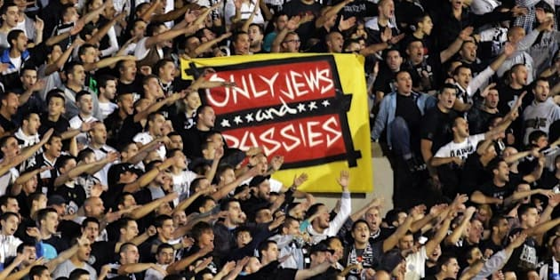 Partizan Belgrade's supporters display an antisemitic banner during the UEFA Europa League match FK Partizan vs Tottenham Hotspur FC in Belgrade on September 18, 2014.  AFP PHOTO / STR        (Photo credit should read STRINGER/AFP/Getty Images)