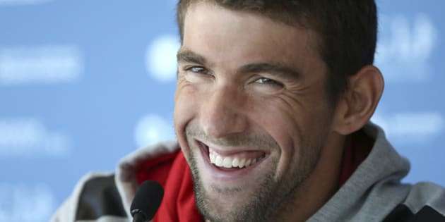 FILE - In this Aug. 20, 2014, file photo, U.S. swimmer Michael Phelps laughs during a press conference ahead of the Pan Pacific swimming championships in Gold Coast, Australia. Authorities say Phelps has been arrested on a DUI charge in Maryland. Transit police say they stopped the 29-year-old Phelps at the Fort McHenry Tunnel in Baltimore around 1:40 a.m. Tuesday, Sept. 30, 2014.(AP Photo/Rick Rycroft, File)