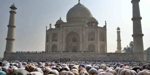 Indian Muslims offer prayers during Eid al-Adha, or the Feast of the Sacrifice, at the Taj Mahal monument in Agra, India, Monday, Oct. 6, 2014. (AP Photo/Pawan Sharma)