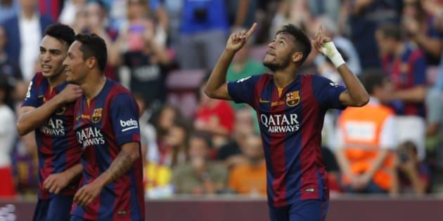 Barcelona's Neymar from Brazil celebrates after scoring during a Spanish La Liga soccer match between F.C. Barcelona and Granada C.F. at the Camp Nou stadium in Barcelona, Spain, Saturday, Sept. 27, 2014. (AP Photo/Emilio Morenatti)