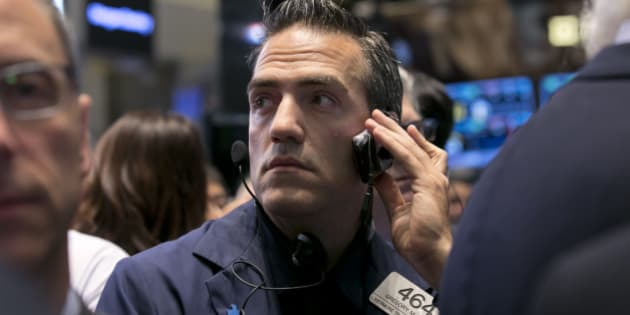 Trader Gregory Rowe works on the floor of the New York Stock Exchange, Thursday, Oct. 2, 2014. U.S. stocks fell for a fourth straight day Thursday, adding to big losses the day before, as energy companies dragged down the broader market. Investors also worked through a report that showed fewer Americans applied for unemployment benefits. (AP Photo/Richard Drew)