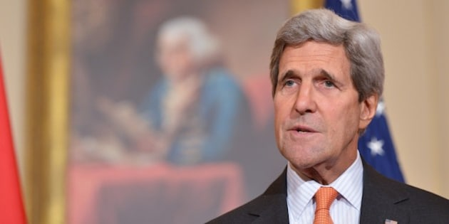 US Secretary of State John Kerry speaks ahead of a working lunch with Vietnamese Deputy Prime Minister and Foreign Minister Pham Binh Minh on October 2, 2014 at the State Department in Washington, DC. AFP PHOTO/Mandel NGAN        (Photo credit should read MANDEL NGAN/AFP/Getty Images)