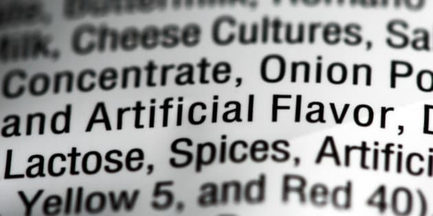 """This Sept. 26, 2014 photo shows the ingredients label on a bag of Nacho Cheese flavored Doritos, in Philadelphia. """"Artificial and natural flavors"""" have become ubiquitous terms on food labels, helping create vivid tastes that would otherwise be lost in mass production. As the science behind them advances, however, some are calling for greater transparency about their safety and ingredients. (AP Photo/Matt Rourke)"""