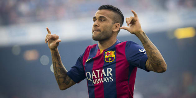 BARCELONA, SPAIN - AUGUST 18:  Dani Alves  of FC Barcelona gestures during the Joan Gamper Trophy match against Club Leon at Camp Nou in Barcelona, Spain on August 18, 2014. (Photo by Albert Llop/Anadolu Agency/Getty Images)