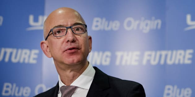 Jeff Bezos, chief executive officer of Amazon.com Inc. and founder of Blue Origin LLC, speaks during a news conference at the National Press Club in Washington, D.C., U.S., on Wednesday, Sept. 17, 2014. The partnership between United Launch Alliance and Bezos's Blue Origin LLC has set a four-year development schedule, with full testing to begin in 2016 and a first flight in 2019, according to a statement today from the companies. The Boeing-Lockheed venture currently handles all U.S. military satellite launches. Photographer: Drew Angerer/Bloomberg via Getty Images