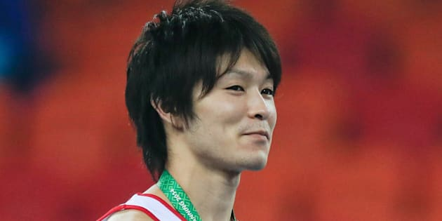 NANNING, CHINA - OCTOBER 09: Gold medalist Kohei Uchimura of Japan celebrates during the medal ceremony after the Men's All-Around Final in day three of the 45th Artistic Gymnastics World Championships at Guangxi Sports Center Stadium on October 9, 2014 in Nanning, China.  (Photo by Lintao Zhang/Getty Images)