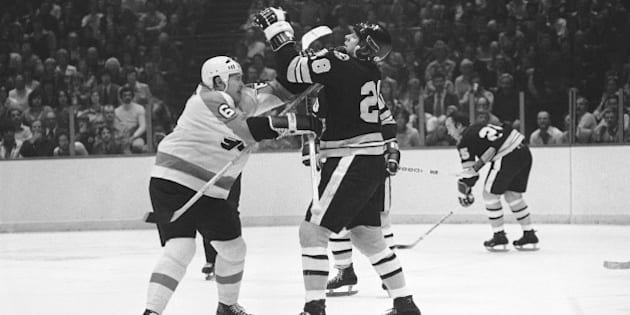 Philadelphia Flyers Andre Dupont (6), left, and Boston Bruins Mike Milbury (28), right, tangle during a fight in semifinal Stanley Cup hockey play in Philadelphia on Thursday, April 29, 1976. Both were penalized for fighting. (AP Photo/Rusty Kennedy)