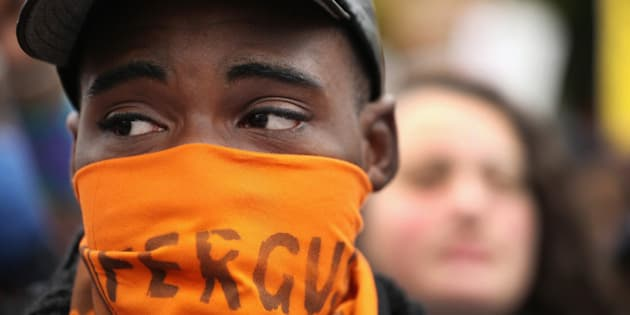 ST LOUIS, MO - OCTOBER 11:  Inspired by the August 9 death of Michael Brown in Ferguson, Missouri, demonstrators march through downtown to protest racial injustice on October 11, 2014 in St. Louis, Missouri. Brown, an 18-year-old black man, was not armed when he was shot and killed by Darren Wilson, a white Ferguson police officer.  (Photo by Scott Olson/Getty Images)