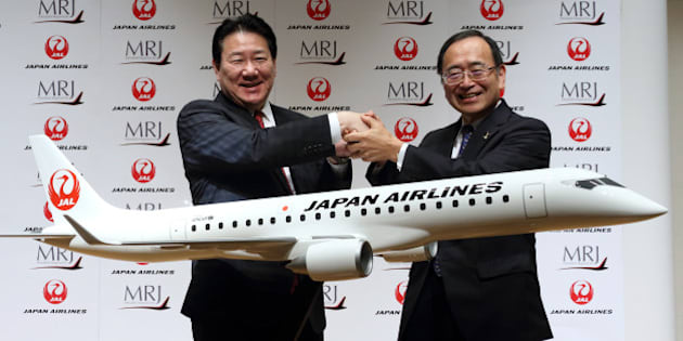 Yoshiharu Ueki, president of Japan Airlines Co. (JAL), left, and Hideo Egawa, chairman and chief executive officer of Mitsubishi Aircraft Corp., shake hands during a news conference in Tokyo, Japan, on Thursday, Aug. 28, 2014. JAL, the country's second-largest airline, agreed to buy 32 planes from Mitsubishi Aircraft to make its fleet more fuel-efficient. Photographer: Tomohiro Ohsumi/Bloomberg via Getty Images