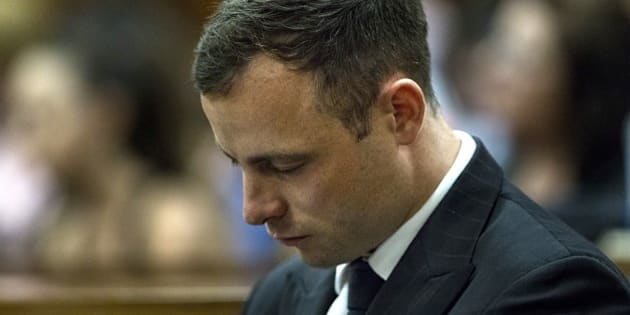 South African Paralympic athlete Oscar Pistorius looks down while his phycologist gives evidences during his sentencing hearing at the High Court in Pretoria on October 13, 2014. Fallen paralympic hero Oscar Pistorius returns to court today at the start of his sentencing hearing after he was convicted of culpable homicide in the killing of his girlfriend, with his lawyers set to argue for leniency. The double-amputee track star last month escaped a murder conviction in a verdict that shocked the country and fuelled criticism of South Africa's legal system. AFP PHOTO/ POOL / MARCO LONGARI        (Photo credit should read MARCO LONGARI/AFP/Getty Images)
