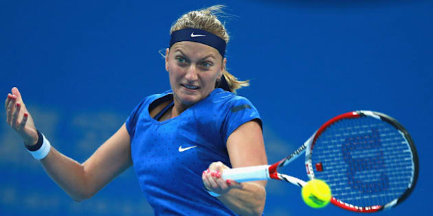 BEIJING, CHINA - OCTOBER 05:  Petra Kvitova of Czech Republic returns a shot during the Women's Single Final against Maria Sharapova of Russia on day nine of the China Open at the China National Tennis Center on October 5, 2014 in Beijing, China.  (Photo by Feng Li/Getty Images)