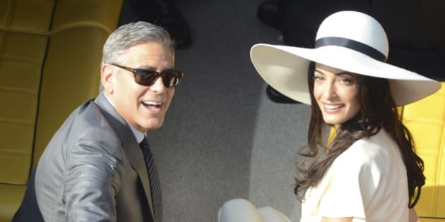 George Clooney and his wife Amal Alamuddin leave the city hall after their civil marriage ceremony in Venice, Italy, Monday, Sept. 29, 2014. George Clooney married human rights lawyer Amal Alamuddin Saturday, the actor's representative said, out of sight of pursuing paparazzi and adoring crowds. (AP Photo/Luigi Costantini)