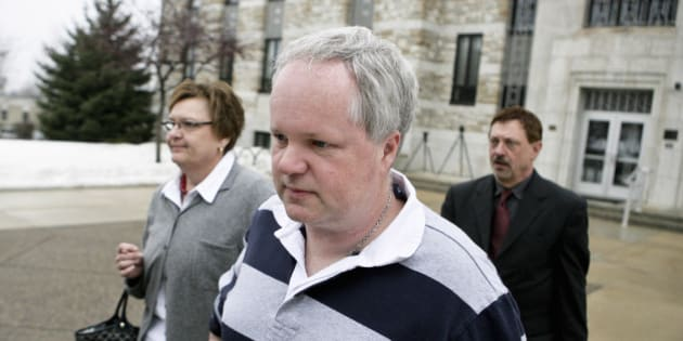 FILE - In this Feb. 17, 2011 file photo, William Melchert-Dinkel, center, leaves the Rice County Courthouse with his attorney Terry Watkins, right, and wife, Joyce Melchert-Dinkel, after waiving his right to a jury trial, in Faribault, Minn. Melchert-Dinkel, 48, of Faribault, faces two counts of aiding suicide, each carrying a maximum sentence of 15 years in prison. Prosecutors say he encouraged two people to take their lives, including 18-year-old Kajouji, of Brampton, Ontario, who jumped into a river in 2008; and 32-year-old Mark Drybrough, of Coventry, England, who hung himself in 2005. (AP Photo/Robb Long, File)