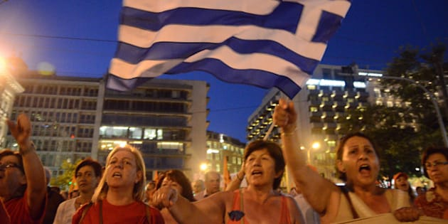 ATHENS, GREECE - 2014/07/03: The demonstrators accuse the Greek government of trying to sell a successful Public Electricity Cooperative that is important for their everyday life, during their protest in the privatization of DEH in Athens. (Photo by George Panagakis/Pacific Press/LightRocket via Getty Images)