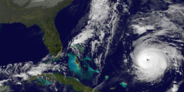 This image provided by NOAA Thursday Oct. 16, 2014 shows Hurricane Gonzalo, lower right. At 2 a.m. EDT Thursday the storm had top sustained winds near 125 mph (205 kph) and was centered about 555 miles (1,075 kilometers) south south-west of Bermuda early Thursday, the U.S. National Hurricane Center said. It was moving north at 9 mph (20 kph). (AP Photo/NOAA)