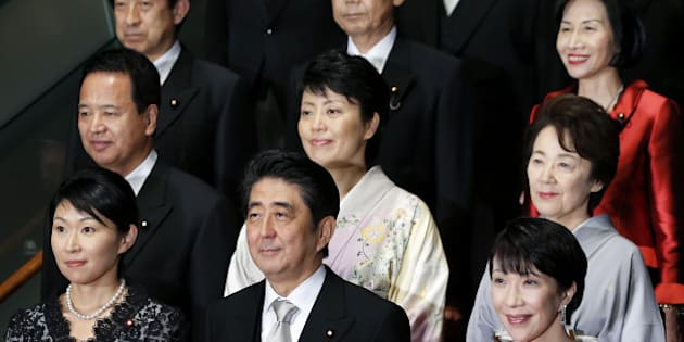 Shinzo Abe, Japan's prime minister, front row center, poses for a group photograph with members of his new cabinet including Yuko Obuchi, Japan's newly appointed economy, trade and industry minister, front row left, and Sanae Takaichi, Japan's newly appointed internal affairs and communications minister, front row right, Haruko Arimura, Japan's newly appointed minister in charge of government revitalization and woman promotion, second row center, Eriko Yamatani, Japan's newly appointed chairwoman of the National Public Safety Commission and minister in charge of abduction issue, second row right, and Midori Matsushima, Japan's newly appointed justice minister, third row right, at the prime minister's official residence in Tokyo, Japan, on Wednesday, Sept. 3, 2014.  Abe placed an advocate of pro-market reforms in charge of the government pension fund and named a rising female politician as industry minister as he seeks to restore momentum to his 'Abenomics' policies with a cabinet reshuffle today. Photographer: Kiyoshi Ota/Bloomberg via Getty Images