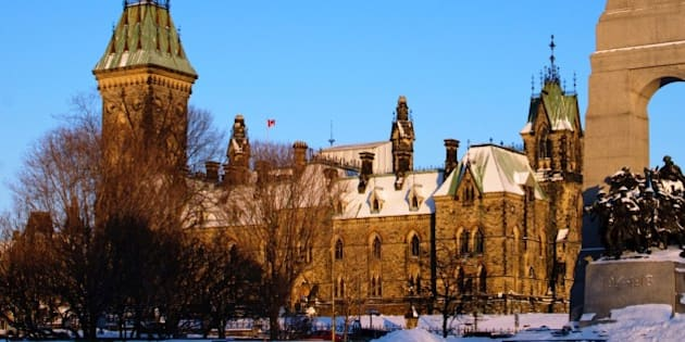 The East Block of the Houses of Parliament in Ottawa, Canada. The National War Memorial is in the foreground.
