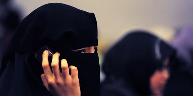 A woman wearing a burqa talks on a mobile phone during the 'Uprising in the Muslim World' Khilafah Conference 2011 in Sydney on July 3, 2011. Around 1,000 Australian Muslims attended the conference hosted by the controversial Islamist group Hizb ut-Tahrir which called for the creation of a global caliphate or Islamic government.  AFP PHOTO / Torsten BLACKWOOD (Photo credit should read TORSTEN BLACKWOOD/AFP/Getty Images)