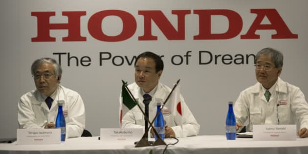 Tetsuo Iwamura, executive vice president of Honda Motor Co., from left, Takanobu Ito, chief executive officer of Honda Motor Co., and Isamu Yamaki, president for Honda of Mexico, attend a press conference at the opening ceremony for Honda Motor Co.'s new plant in Celaya, Mexico, on Friday, Feb. 21, 2014. Honda Motor Co., following record auto production in North America, opened its seventh auto-assembly plant as the Japanese carmaker seeks to boost sales in the region with locally sourced vehicles. Photographer: Susana Gonzalez/Bloomberg via Getty Images