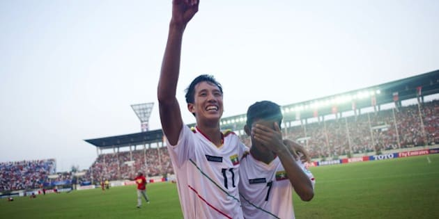 Than Paing of Myanmar (C) celebrates after winning the AFC U-19 Championship quarter-final football match between Myanmar and the United Arab Emirates at Thuwanna stadium in Yangon on October 17, 2014. Myanmar won the match 1-0, securing a place in the U20 world cup. AFP PHOTO / Ye Aung THU        (Photo credit should read Ye Aung Thu/AFP/Getty Images)