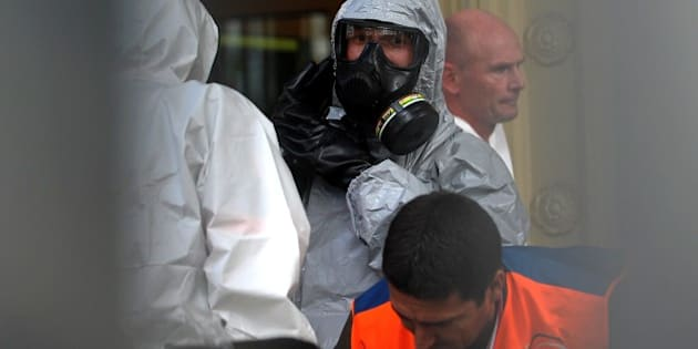 Chemical and biological experts prepare to intervene on October 24,2014 at the German Consulate in Istanbul. Suspicious envelopes containing a yellow powder were sent on October 24 to the Belgian, Canadian and German consulates in Istanbul, prompting a security alert. There was no immediate claim of responsibility but the incident came amid mounting concerns about the growing national security threat posed by jihadists returning from war-ravaged Syria and Iraq. AFP PHOTO/OZAN KOSE        (Photo credit should read OZAN KOSE/AFP/Getty Images)