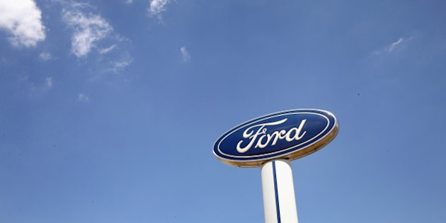 MELROSE PARK, IL - JUNE 03:  A Ford logo stands above the Al Piemonte Ford dealership on June 3, 2013 in Melrose Park, Illinois. Ford Motor Company posted a 14 percent increase in May U.S. sales compared with a year ago.  (Photo by Scott Olson/Getty Images)