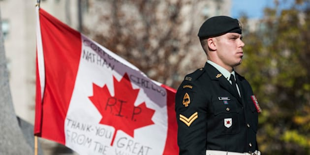 OTTAWA, ON - OCTOBER 24:  A soldier in the Canadian Army stands guard at the National War Memorial during a ceremony at the memorial on October 24, 2014 in Ottawa, Canada.  Two days ago a gunman killed Cpl. Nathan Cirillo, a soldier guarding the memorial. The gunman then stormed the main parliament building, terrorizing the public and politicians, before he was shot dead.  (Photo by Andrew Burton/Getty Images)