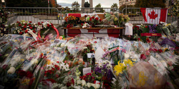 OTTAWA, ON - OCTOBER 23:  Flowers and wreaths are left in memorial of Cpl. Nathan Cirillo of the Canadian Army Reserves, who was killed yesterday while standing guard in front of the National War Memorial by a lone gunman, on October 23, 2014 in Ottawa, Canada. After killing Cirillo the gunman stormed the main parliament building, terrorizing the public and politicians, before he was shot dead.  (Photo by Andrew Burton/Getty Images)