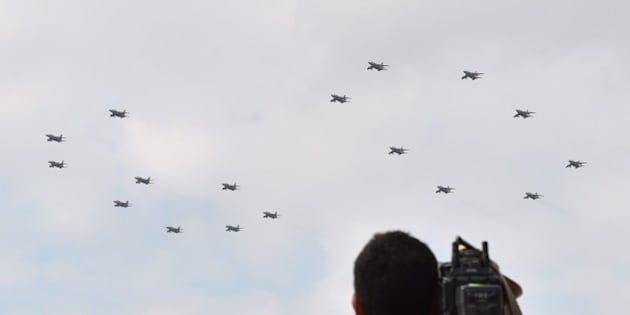 Military jet planes perform a flying formation of the number '60' to commemorate the 60th anniversary of Japan Self-Defense Forces Day -- the Military of Defense 60th Anniversary Air Review 2014 -- at the Hyakuri air base in Omitama, Ibaraki prefecture on October 26, 2014. 80 military aircrafts, 25 vehicles and 740 troops participated in the air review. AFP PHOTO / KAZUHIRO NOGI        (Photo credit should read KAZUHIRO NOGI/AFP/Getty Images)