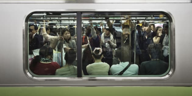 A crowded Tokyo Yamanote Line commuter train during a busy period on Saturday when people go out to shop