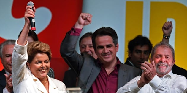 Re-elected Brazilian President Dilma Rousseff celebrates following her win, in Brasilia on October 26, 2014. Leftist incumbent Dilma Rousseff was re-elected president of Brazil, the country's Supreme Electoral Tribunal said, after a down-to-the-wire race against center-right challenger Aecio Neves. Rousseff, who had 51.45 percent of the vote with 98 percent of ballots counted, was declared the run-off winner. AFP PHOTO / EVARISTO SA        (Photo credit should read EVARISTO SA/AFP/Getty Images)