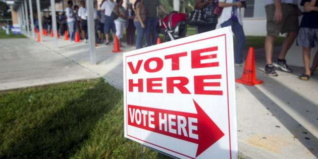 "People stand in line to vote early Sunday, Oct. 28, 2012, in Pembroke Pines, Fla. On the only Sunday that Florida polls will be open for early voting this election cycle, faith leaders from 44 congregations in six Florida cities will lead their congregations to early voting locations in a massive ""Souls to the Polls"" effort to mobilize faith voters. (AP Photo/J Pat Carter)"