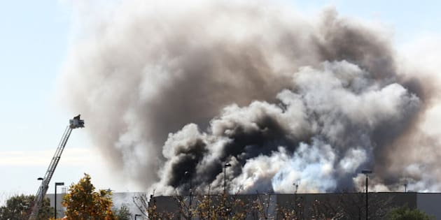 Smoke billows from a building at at Mid-Continent Airport in Wichita, Kan., Thursday, Oct. 30, 2014 shortly after a Beechcraft King Air B200 crashed into the building, killing several people, including the pilot. (Brian Corn/Wichita Eagle/MCT via Getty Images)