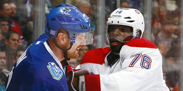 VANCOUVER, BC - OCTOBER 30:  Daniel Sedin #22 of the Vancouver Canucks and P.K. Subban #76 of the Montreal Canadiens battle along the boards during their NHL game at Rogers Arena October 30, 2014 in Vancouver, British Columbia, Canada.  (Photo by Jeff Vinnick/NHLI via Getty Images)
