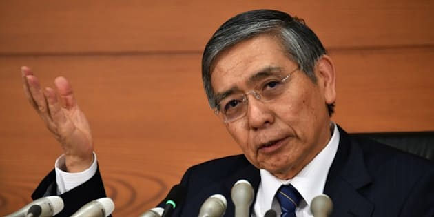 Bank of Japan (BOJ) Governor Haruhiko Kuroda speaks to the press at the BOJ headquarters in Tokyo on October 31, 2014. The BOJ ramped up its vast monetary easing programme following a string of poor data that has fanned fears the economy may contract again in the third quarter.  AFP PHOTO / Yoshikazu TSUNO        (Photo credit should read YOSHIKAZU TSUNO/AFP/Getty Images)