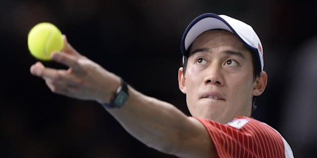 Japan's Kei Nishikori serves the ball to Serbia's Novak Djokovic  during the semi-finals of the ATP World Tour Masters 1000 indoor tennis tournament on November 1, 2014 at the Bercy Palais-Omnisport (POPB) in Paris. AFP PHOTO / MIGUEL MEDINA        (Photo credit should read MIGUEL MEDINA/AFP/Getty Images)