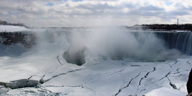 ONTARIO, CANADA- MARCH 10:A view of the Niagara Falls frozen over due to the extreme cold weather, Canada, North America, on March 10, 2014. The Polar Vortex brought record cold temperatures from Kansas to Maine. The views attract attention by many photographers and tourists. (Photo by Seyit Aydogan/Anadolu Agency/Getty Images)