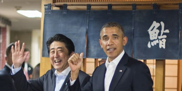 US President Barack Obama (R) and Japanese Prime Minister Shinzo Abe (L) depart after a private dinner at Sukiyabashi Jiro restaurant in Tokyo on April 23, 2014.   Obama landed in Tokyo on April 23 to launch an Asian tour dedicated to reinvigorating his policy of 'rebalancing' US foreign policy towards a dynamic Asia.   Sukiyabashi Jiro's less-than-plush surroundings notwithstanding, it is the proud possessor of three Michelin stars, and people flock to pay a minimum $300 for 20 pieces of sushi chosen by the 88-year-old patron, Jiro Ono.    AFP PHOTO / Jim WATSON        (Photo credit should read JIM WATSON/AFP/Getty Images)