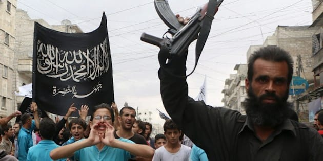 Supporters of the Al Nusra Front take part in a protest against Syrian President Bashar al-Assad and the international coalition in Aleppo on September 26, 2014. The US struck a little-known group called 'Khorasan' on September 24, but experts and activists argue it actually struck Al-Qaeda's affiliate Al-Nusra Front, which fights alongside Syrian rebels. AFP PHOTO/ Fadi al-Halabi        (Photo credit should read Fadi al-Halabi/AFP/Getty Images)