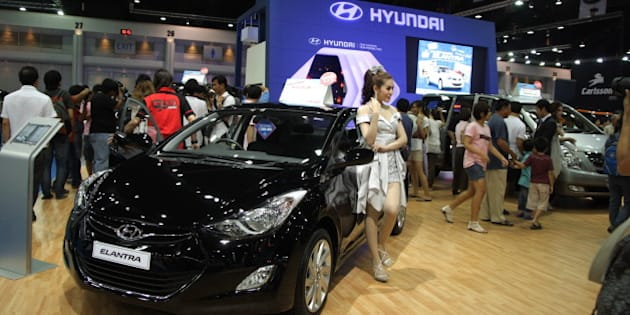 BANGKOK, THAILAND - 2012/04/07: A presenter posing with Hyundai Elantra  at The 33rd Bangkok International Motorshow. The 33rd Bangkok International Motorshow will be held from March 28 to April 8. The show is expected to attract more than 1.7 million visitors this year with automakers launching their new products manufactured under the auspices of the governments ecologically-friendly car project and aimed to pull the auto industries back from its crisis caused by the devastating 2011 floods. (Photo by Piti A Sahakorn/LightRocket via Getty Images)