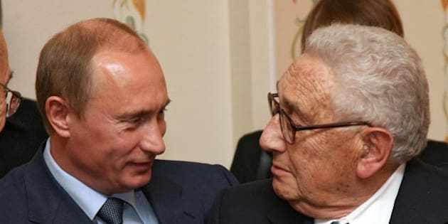 Moscow, RUSSIAN FEDERATION: Russian President Vladimir Putin (L) shakes hands with former US secretary of State Henry Kissinger (R) during the meeting of Russian-US public working group 'Russia-US : look into the future' in Novo-Ogaryovo residence outside Moscow 13 July 2007. Vladimir Putin said Russian-US relations should be oriented towards the interests of the two countries' people and should not be dependent on current political trends in each country.   AFP PHOTO/ POOL/ SERGEI CHIRIKOV (Photo credit should read SERGEI CHIRIKOV/AFP/Getty Images)