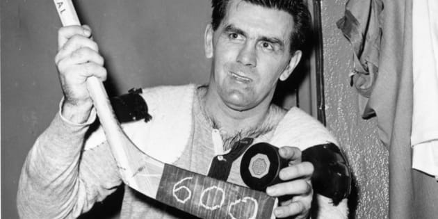 "Maurice ""the Rocket"" Richard of the Montreal Canadiens poses with his hockey stick marked 600 and a puck after game against New York Rangers in New York City, Nov. 26, 1958.  Richard scored his 600th goal of his National Hockey League career.  (AP Photo)"