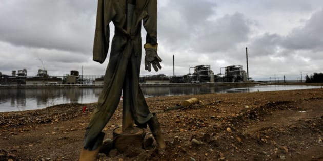 FORT MCMURRAY, AB - JUNE 20: A crude scarecrow is used to thwart birds from landing in the water of the tailings ponds at the Syncrude oil processing facility.There is explosive growth in the oil field areas around Fort McMurray, Alberta, Canada. The oil extracted from this area is the product that would travel through the proposed Keystone XL oil pipeline.(Photo by Michael S. Williamson/The Washington Post via Getty Images