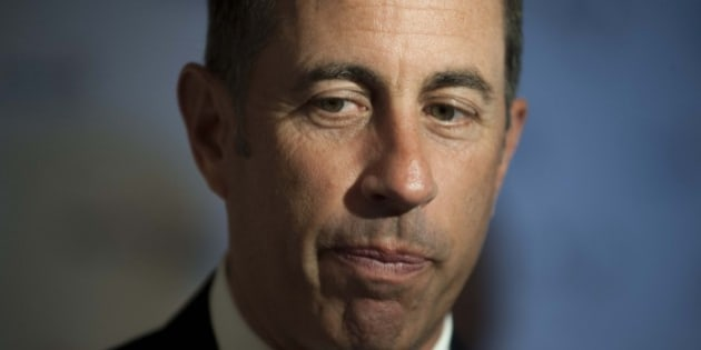 Jerry Seinfeld pauses as he is interviewed on the red carpet at the Kennedy Center for the Performing Arts for the Mark Twain Prize for American Humor on Sunday, Oct. 19, 2014, in Washington.  (AP Photo/Kevin Wolf)