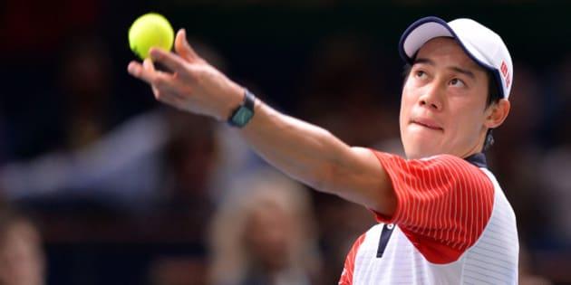 PARIS, FRANCE - NOVEMBER 01 :  Kei Nishikori of Japan serves against Novak Djokovic of Serbia (not seen) during the BNP Paribas Masters 2014 tennis tournament semi-finals match  in Paris, France on November 01, 2014.  (Photo by Mustafa Yalcin/Anadolu Agency/Getty Images)