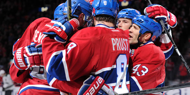 MONTREAL, QC - NOVEMBER 8:  Lars Eller #81 of the Montreal Canadiens celebrates his second period goal with teammates during the NHL game against the Minnesota Wild at the Bell Centre on November 8, 2014 in Montreal, Quebec, Canada.   (Photo by Richard Wolowicz/Getty Images)
