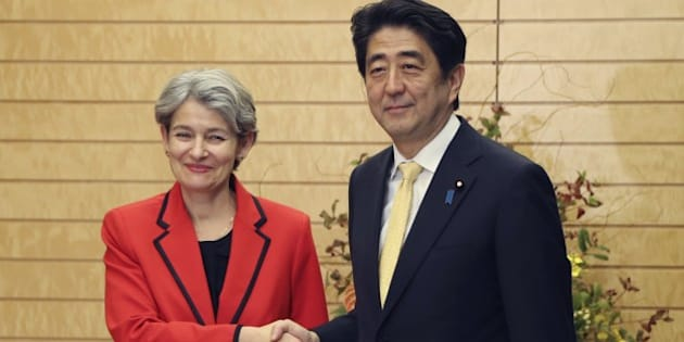 Director General of UNESCO Irina Bokova (L) shakes hands with Japanese Prime Minister Shinzo Abe prior to their meeting at Abe's official residence in Tokyo on November 7, 2014.    AFP PHOTO / POOL        (Photo credit should read KOJI SASAHARA/AFP/Getty Images)