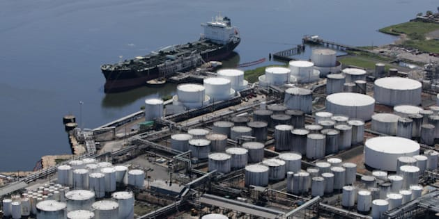 An oil tanker is docked at the Kinder Morgan terminal on Sept. 8, 2008 in Carteret, N.J. Kinder Morgan Energy Partners LP operates pipelines and terminals for oil and natural gas. (AP Photo/Mark Lennihan)
