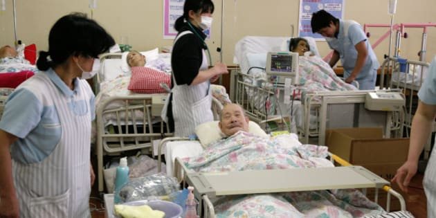 Elderly patients, who were forced to move from a hospital near the Fukushima nuclear plant 60 kms to the north, receive care from nurses at a hospital in Koriyama in Fukushima prefecture on March 17, 2011.  Japanese military helicopters dumped tonnes of water onto the stricken Fukushima nuclear power plant northeast of Tokyo in a bid to douse fuel rods and prevent a disastrous radiation release. AFP PHOTO / Go TAKAYAMA (Photo credit should read GO TAKAYAMA/AFP/Getty Images)